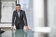 Portrait of confident businessman in office - ZEF14661