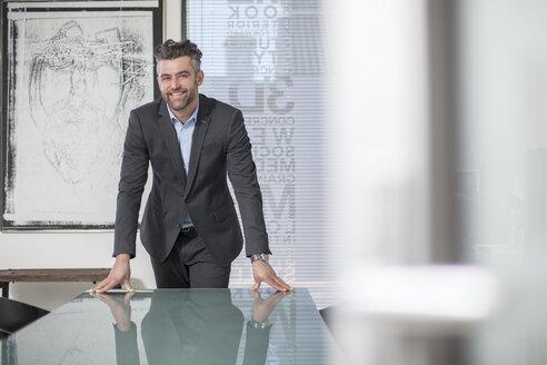 Portrait of confident businessman in office - ZEF14661