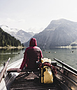 Austria, Tyrol, Alps, woman in boat on mountain lake - UUF11952