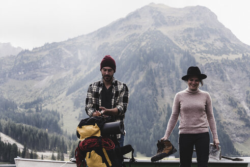 Austria, Tyrol, Alps, couple with backpack and hiking boots in alpine landscape - UUF11979