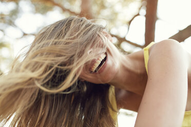 Portrait of laughing young woman with blowing hair - PNEF00218