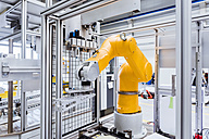 Industrial robot on factory shop floor - DIGF02913