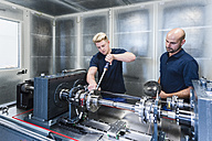 Two colleagues working in modern factory - DIGF02953