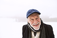 Portrait of laughing senior man in snow - HAPF02226