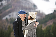 Happy senior couple in winter landscape - HAPF02238