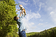 Father throwing baby in the air - HAPF02298