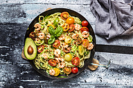 Frying pan of spaghetti with zoodles, guacamole, tomatoes and shrimps - SARF03382