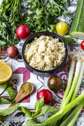 Bowl of Bulgur and ingredients for preparing Tabbouleh - SARF03388
