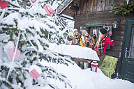 Austria, Altenmarkt-Zauchensee, female friends celebrating at wooden house at Christmas time - HHF05504