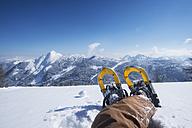 Austria, Salzburg State, Altenmarkt-Zauchensee, man with snowshoes lying in deep snow - HHF05507
