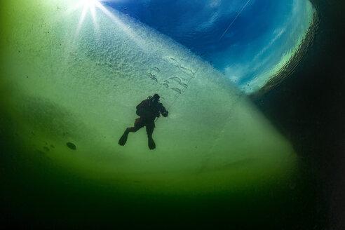 Austria, Styria, Lake Grundlsee, scuba diver under ice floe - YRF00165