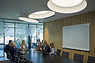 Group of business people discussing in meeting - ZEDF00904