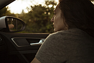 Serious young woman in car - FEXF00306