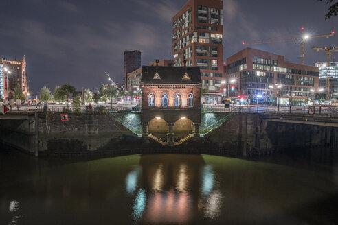 Germany, Hamburg, Speicherstadt, lighted old building Fleetschloesschen in the evening - PVCF01100