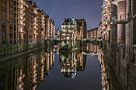 Germany, Hamburg, Speicherstadt, lighted old buildings with Elbe Philharmonic Hall in the background - PVCF01103