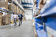 Business people meeting in company storehouse - DIGF02964