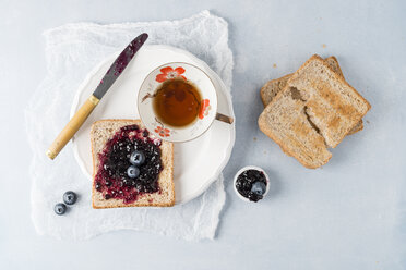 Toast with blueberry jam and cup of tea - MYF01977