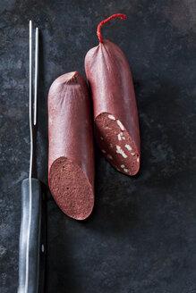 Fresh blood sausage on dark background - CSF28443