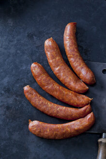 Five minced meat sausages on dark background - CSF28458