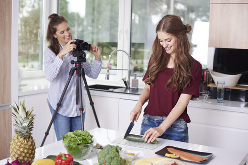 Women recording video for their food blog - ABIF00024