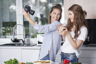 Food bloggers taking selfie with digital camera - ABIF00042
