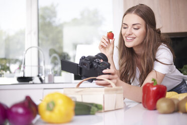 Food blogger filming herself eating strawberry - ABIF00045