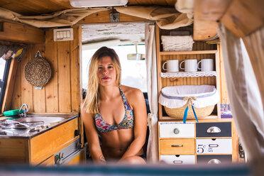 Spain, Tenerife, portrait of young woman in van - SIPF01825