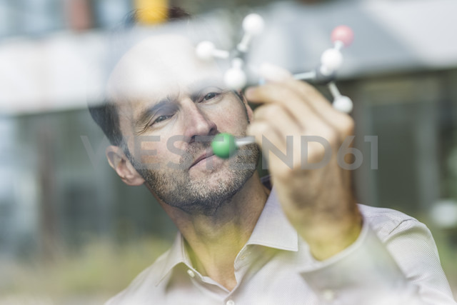 Portrait of scientist with atomic model - UUF12084