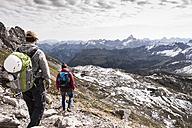 Germany, Bavaria, Oberstdorf, two hikers walking in alpine scenery - UUF12118