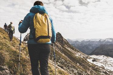 Germany, Bavaria, Oberstdorf, hikers walking in alpine scenery - UUF12121