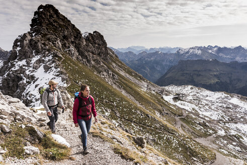 Germany, Bavaria, Oberstdorf, two hikers walking in alpine scenery - UUF12124