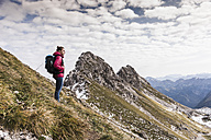 Germany, Bavaria, Oberstdorf, hiker in alpine scenery - UUF12127