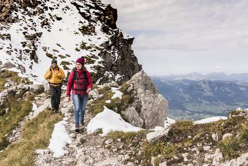 Germany, Bavaria, Oberstdorf, two hikers walking in alpine scenery - UUF12133