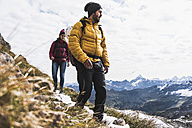 Germany, Bavaria, Oberstdorf, two hikers walking in alpine scenery - UUF12142