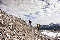 Germany, Bavaria, Oberstdorf, two hikers walking up stony mountain - UUF12148