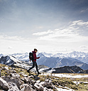 Germany, Bavaria, Oberstdorf, hiker walking in alpine scenery - UUF12163