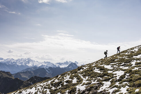 Germany, Bavaria, Oberstdorf, two hikers walking up alpine meadow - UUF12169