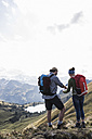 Germany, Bavaria, Oberstdorf, two hikers with map in alpine scenery - UUF12178