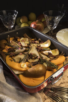 Vegan oven vegetables with pumpkin, pears and spices in roasting tray - CSTF01409