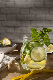 Glass of detox water with mint, ginger, rosmary and limes - CSTF01414