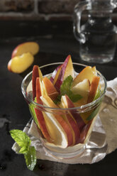 Glass of detox water with sliced red apple and mint - CSTF01417