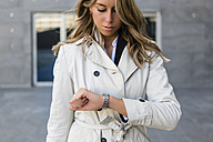 Businesswoman checking the time - MGIF00195