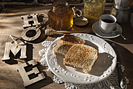 Breakfast table with toast, orange marmalade, honey and espresso - CSTF01435