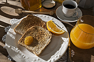 Breakfast table with toast, orange marmalade, honey, orange juice and espresso - CSTF01438