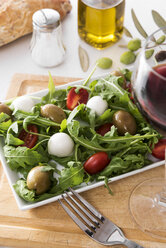 Rocket salad with olive, tomato and mozzarella, olive oil, red wine - CSTF01452
