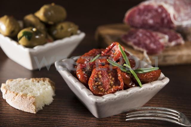 Antipasti, pickled olives, pickled tried tomato, olive bread, salami - CSTF01455
