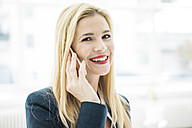 Portrait of smiling businesswoman on the phone - MOEF00213