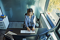 Businesswoman using computer in office - ZEDF00928