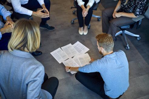 Business team having a workshop in office - ZEDF00949