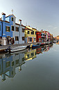 Italy, lagoon of Venice, Burano, boats on canal and colorful houses - RPSF00017